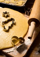 baking scenery with heart shaped cookie cutter, dough, rolling pin
