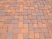 an abstract view of a patterned brick sidewalk