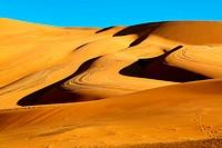 Sahara desert sand dunes with blue sky