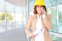 A pretty business construction woman at office building