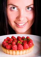 Young beautiful woman with raspberry cake