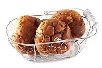 Three raisin buns on a white background.