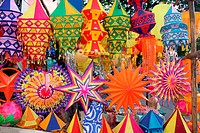 A background of beautiful lanterns in traditional colors and design for Diwali / Christmas festival in India.