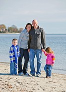 Happy family standing on a beach portrait