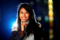 Portrait of a beautiful asian girl at night. Shallow DOF.