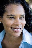 Portrait of African American Woman Smiling and Looking Away From Camera