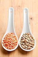 the red and brown lentils in porcelain spoon