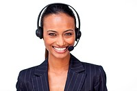 Portrait of a beautiful ethnic businesswoman with a headset on smiling at the camera