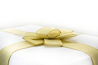 Box with golden bow on white background
