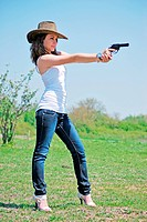 girl and pistol portrait outdoors in farm