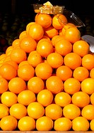 Oranges stacked in display outside of store