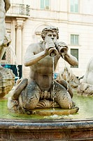 Fountain with satin blow in the horn in piazza navona in rome