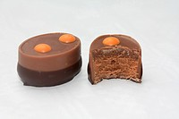 Belgium chocolate praline with an orange decoration