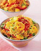 Pasta with king prawns, ham and vegetables
