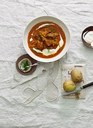 Hungarian goulash with sauerkraut and sour cream