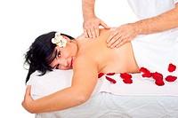 Real professional masseur massaging smiling woman back at spa resort