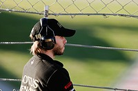 Portrait of Nick Heidfeld, ENG, Lotus Renault GP, observing events through a fence, Formula 1 testing at the Circuit de Catalunya race track near Barc...