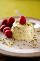 Pistachio ice cream with raspberries