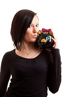 young woman piggy bank shoulder kiss