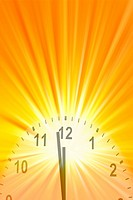 Clock face displaying midday. On bright background.