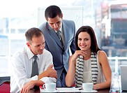 Young businesswoman working with colleagues in office
