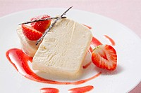 Vanilla parfait garnished with strawberries
