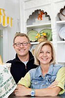 Portrait of mature couple in cake shop
