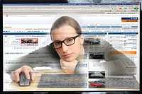 Young woman sitting at a computer surfing the Internet, viewing a page for buying and selling vehicles, autoscout24.de, view from within the computer,...