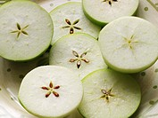 Slices of Green Apples with Seed Patterns