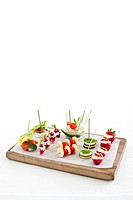 Various canapes on a chopping board
