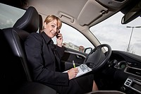 Businesswoman working in her car