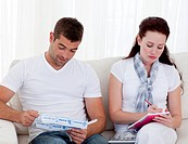 Couple studying their budget in the living_room