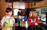 Children cooking spaghetti