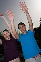 Couple with hands up