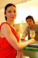 Woman having a refreshment at the bar after a spa treatment (thumbnail)