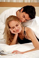 Couple relaxing in bed (thumbnail)