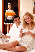 Couple on bed in hotel room