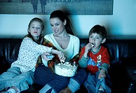 Mother and children watching television (thumbnail)