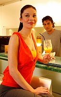 Woman having a refreshment at the bar after a spa treatment