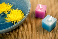 yellow chrysanthemums and aromatherapy candles