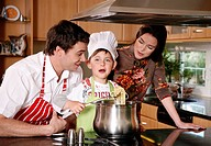 Parents and son cooking spaghetti