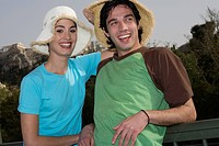 Couple at archaeological site posing with hats