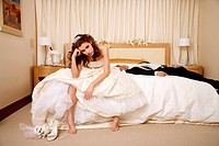 Bride disappointed with groom passed out on hotel bed