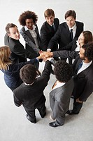 Business team members link hands in solidarity