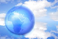 Africa on globe over blue sky with clouds.