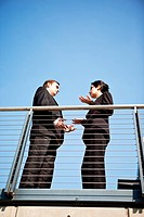 A shot of two business colleagues having a discussion outdoor