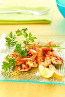 tasty grilled prawn salad with lemon and parsley