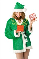 cute green santa claus opening a red present box