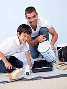 Father and son painting a room together at home