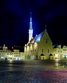 Tallinn town hall at night in Raekoya square showing the floodlit spire and tower of the hall